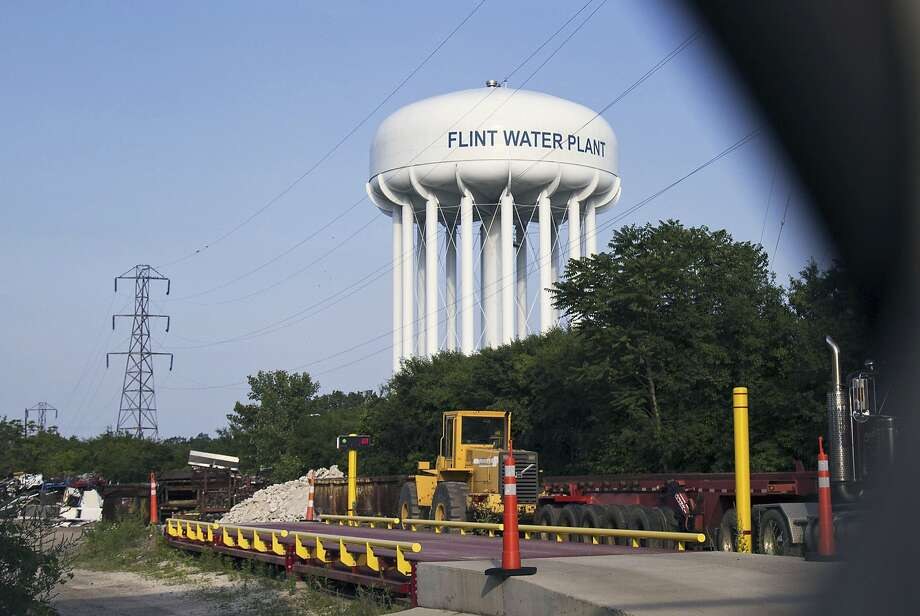 The Flint Water Plant tower is seen in Flint, Mich. Two California bills are aimed at the issue of elevated lead levels in water, an issue that gained nationwide attention because of high levels in Flint. Photo: Shannon Millard, Associated Press