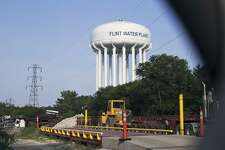 FILE - In this June 14, 2017, file photo, the Flint Water Plant tower is seen in Flint, Mich. A federal appeals court on Friday, July 28, 2017, says Flint residents who used lead-contaminated water can pursue constitutional claims against Michigan and city officials. (Shannon Millard/The Flint Journal-MLive.com via AP, File)