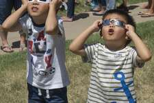 Andrew Zhang, 5 and Liam Zhang, 3 and others from around the Permian Basin crowd the grounds at Museum of the Southwest 8/21/17 afternoon to view the solar eclipse.  Tim Fischer/Reporter-Telegram