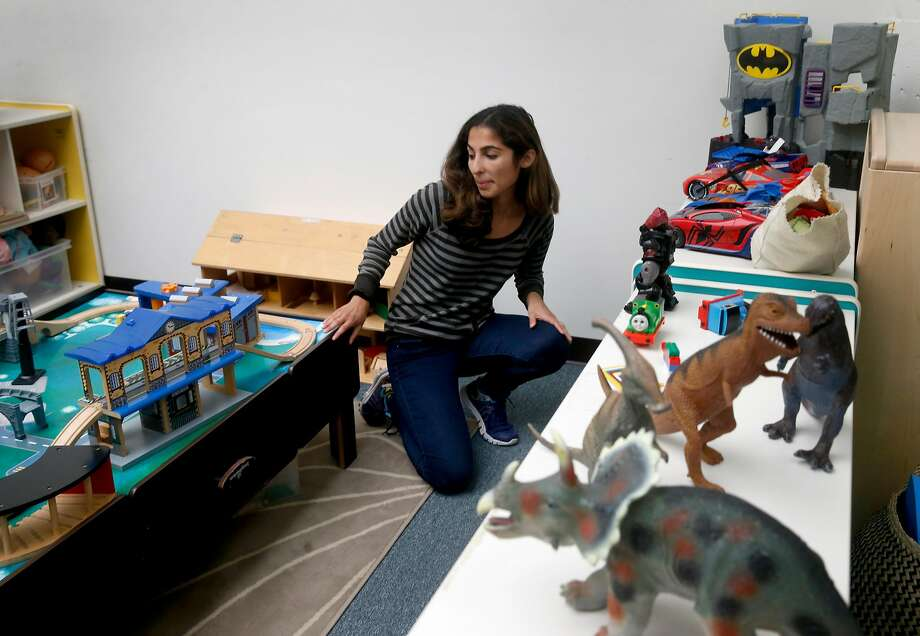 Michaela Azzopardi rearranges an assortment of toys at her job as a childcare specialist for Support for Families of Children with Disabilities in San Francisco. Azzopardi has filed a claim seeking unpaid back wages from Wondersitter, for which she previously worked as a contractor. Photo: Paul Chinn, The Chronicle