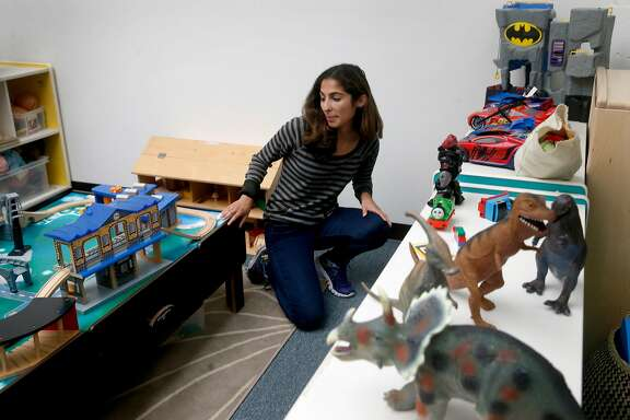 Michaela Azzopardi rearranges an assortment of toys at her job as a childcare specialist for Support for Families of Children with Disabilities in San Francisco, Calif. on Saturday, Aug. 19, 2017. Azzopardi has filed a claim seeking unpaid back wages from a previous employer, Wondersitter, which filed for bankruptcy.
