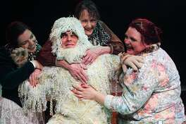 """Brianna Bonnette, left, Teresa McLemore and Karen Rush portray three Victorian explorers who have an encounter with a yeti, played by Edward Waddell, in the women's travels in Pasadena Little Theatre's production of """"On the Verge or the Geography of Yearning"""" by Eric Overmyer. The yeti role is but one of eight that Waddell plays in the production."""