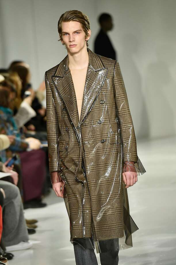 The removable plastic overlays Raf Simons showed in his first Calvin Klein 205W39NYC collection on coats, including the men's double-breasted Wall Street overcoat (pictured), bring a little futurism to an otherwise traditional piece, all combined in Simons' inimitable, sharp style. If the $3,995 price is out of reach, you can always layer a clear rain poncho over an existing coat, or just leave the plastic on from the dry-cleaners. www.calvinklein.com. Photo: Catwalking, Getty Images
