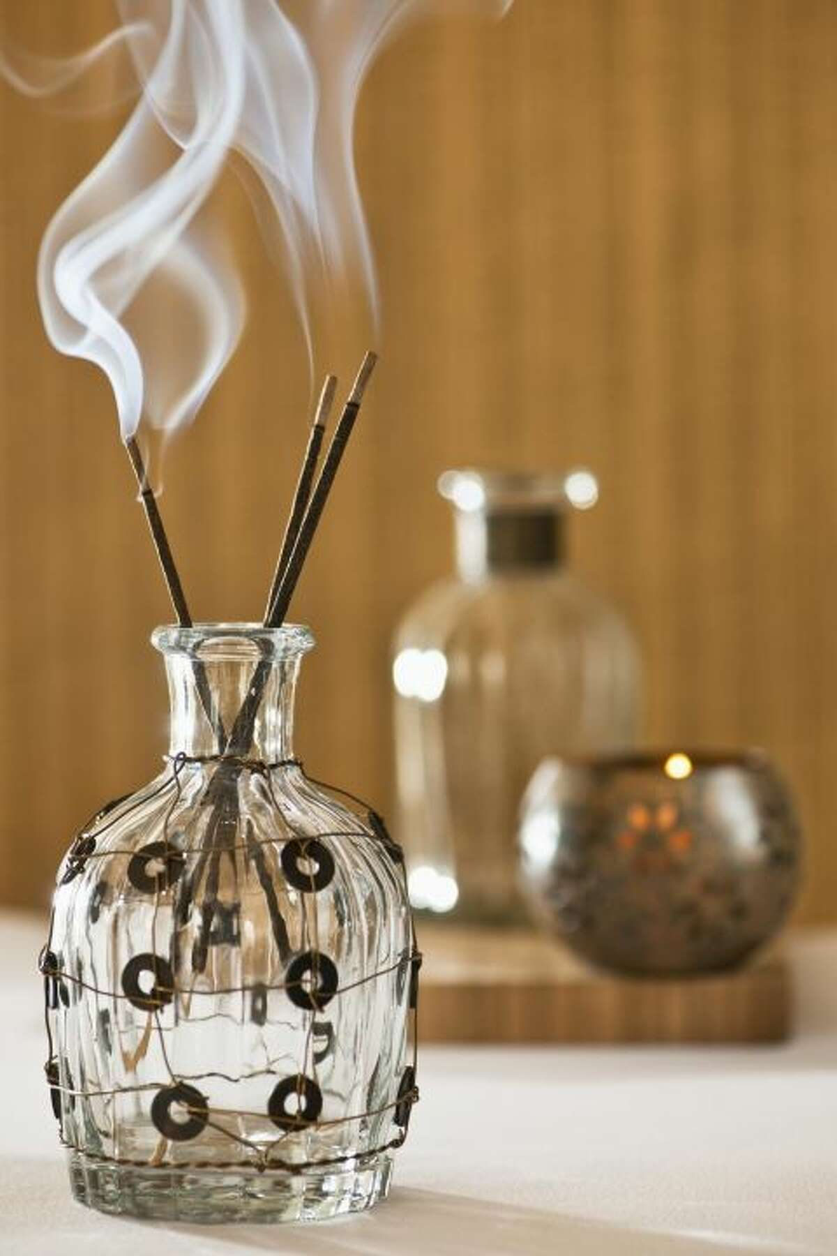 CAREFULLY BURN SOME INCENSE. This fragrant smoke has long been a spiritual and meditation practice - so why not try it at home? Christmann says it'll help elevate the energy: