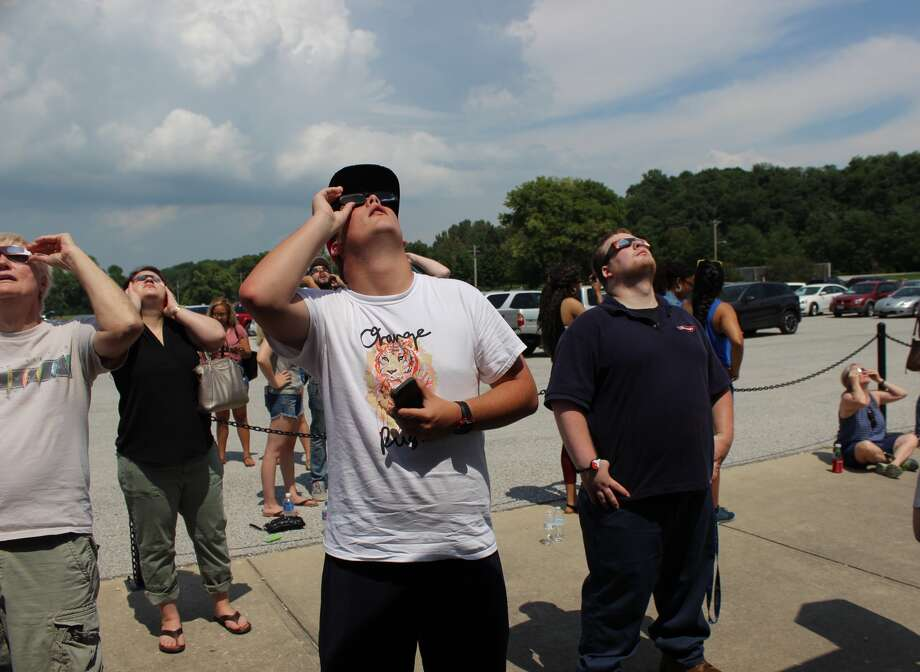 The sky got dimmer during Monday's solar eclipse as crowds gathered at SIUE's Korte Stadium for a public viewing event.