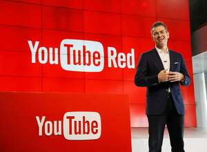 "Robert Kyncl, YouTube Chief Business Officer, speaks as YouTube unveils ""YouTube Red,"" a new subscription service, at YouTube Space LA Wednesday, Oct. 21, 2015, in Los Angeles. The service combines ad-free videos, new original series and movies from top YouTubers like PewDiePie, and on-demand unlimited streaming music for $10 a month. (AP Photo/Danny Moloshok)"