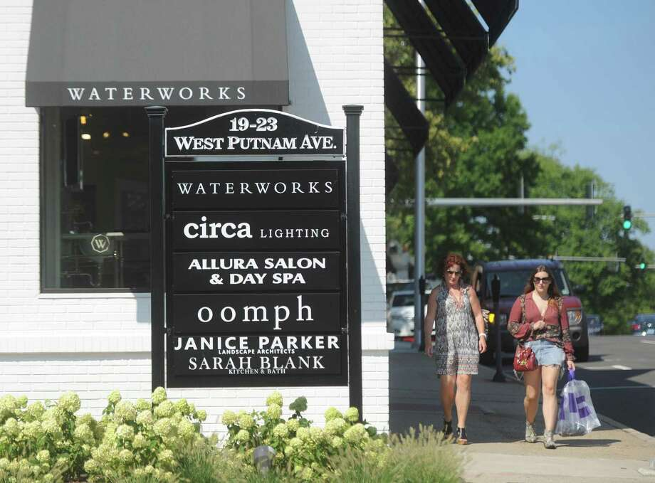 Shoppers stroll past a group of businesses on West Putnam Avenue in Greenwich, Conn. Wednesday, Aug. 9, 2017. More Greenwich business owners believe business conditions are a major concern, according to results from the Greenwich Chamber of Commerce's annual Survey of Business Attitudes. Photo: Tyler Sizemore / Hearst Connecticut Media / Greenwich Time