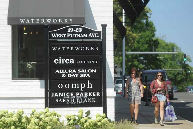Shoppers stroll past a group of businesses on West Putnam Avenue in Greenwich, Conn. Wednesday, Aug. 9, 2017. More Greenwich business owners believe business conditions are a major concern, according to results from the Greenwich Chamber of Commerce's annual Survey of Business Attitudes.