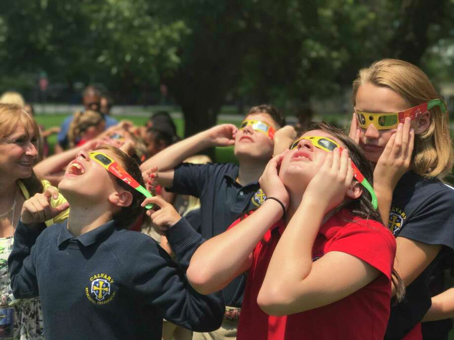 Calvary Episcopal Preparatory students Paul Lazarou, Chance Ostera, Lena Lowry and Avery DeYoung view the Aug. 21 eclipse. Photo: Calvary Episcopal Preparatory