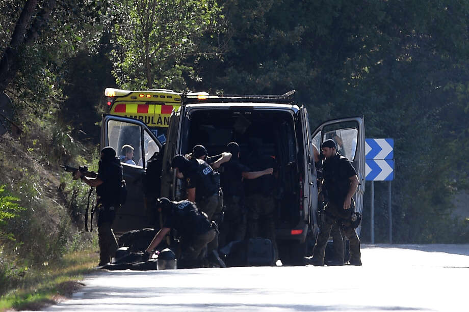 Members of TEDAX-NRBQ (Technician Specialist in Deactivation of Explosive Artifacts) on the site where Moroccan suspect Younes Abouyaaqoub was shot on August 21, 2017 near Sant Sadurni d'Anoia, south of Barcelona, four days after the Barcelona and Cambrils attacks that killed 15 people. Spanish police said on August 21, 2017 that they have identified the driver of the van that mowed down pedestrians on the busy Las Ramblas boulevard in Barcelona, killing 13. The 22-year-old Moroccan Younes Abouyaaqoub is believed to be the last remaining member of a 12-man cell still at large in Spain or abroad, with the others killed by police or detained over last week's twin attacks in Barcelona and the seaside resort of Cambrils that claimed 14 lives, including a seven-year-old boy. Photo: LLUIS GENE/AFP/Getty Images