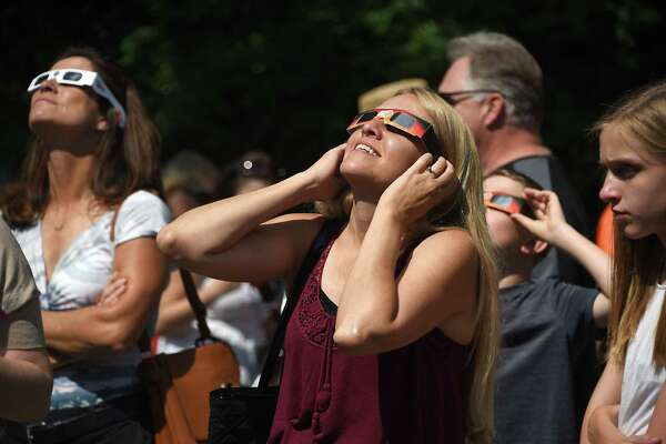 People use special eclipse glasses to watche the the solar eclipse from the Dudley Observatory at miSci on Monday Aug. 21, 2017 in Schenectady, N.Y. (Lori Van Buren / Times Union)