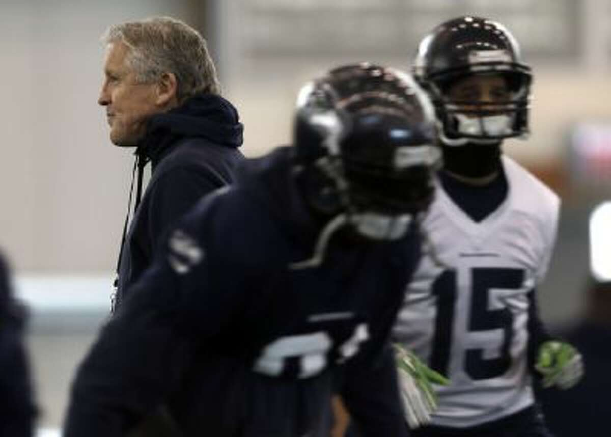 The Seahawks have used a run-first approach and strong defense to reach the Super Bowl, opposite of the high-scoring Broncos.