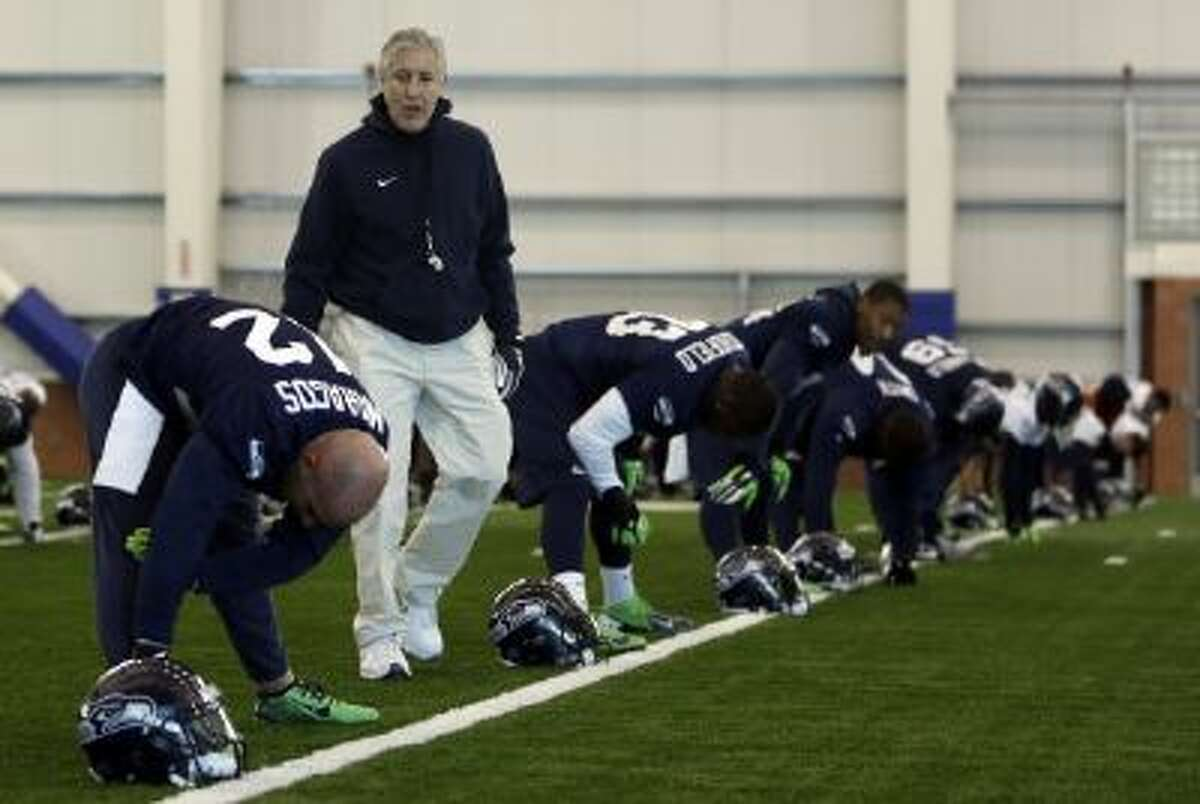 Seattle Seahawks head coach Pete Carroll watches his team warm up at the start practice Wednesday in East Rutherford, N.J.