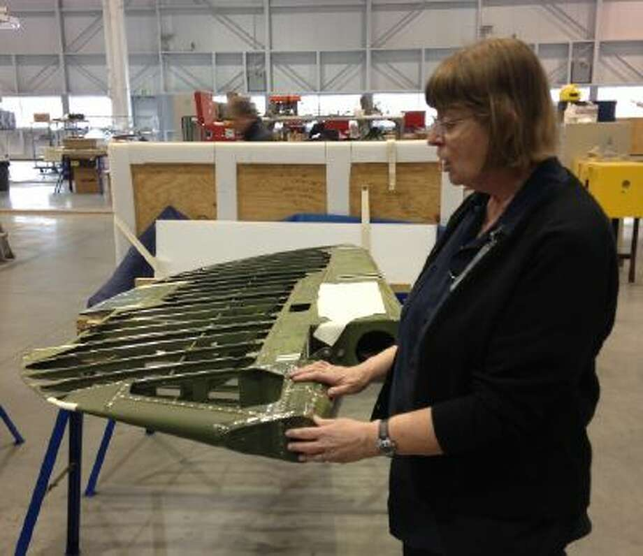 Restoration specialist Anne McCombs discusses how she will restore part of a World War II-era plane's rudder for display at the Smithsonian National Air and Space Museum's Udvar-Hazy Center.