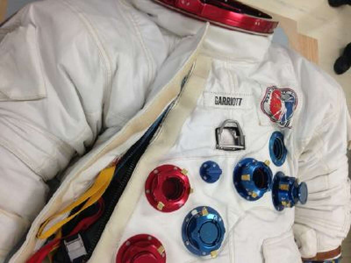 Close up of spacesuit worn by astronaut Owen Garriott on the Skylab space station seen at the National Air and Space Museum's Udvar-Hazy Center in Chantilly, Va.