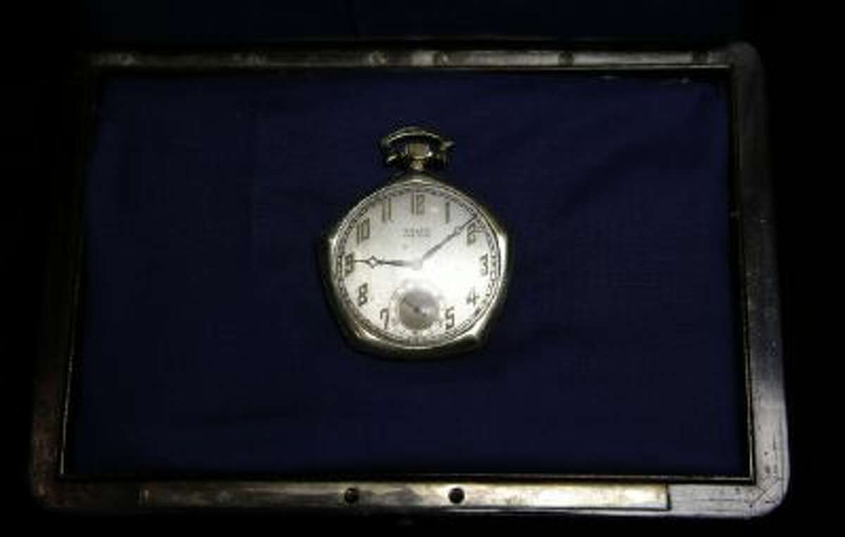 A pocket watch that was given to Babe Ruth in 1923 is displayed at Heritage Auctions office in Dallas, Wednesday, Jan. 22, 2014.