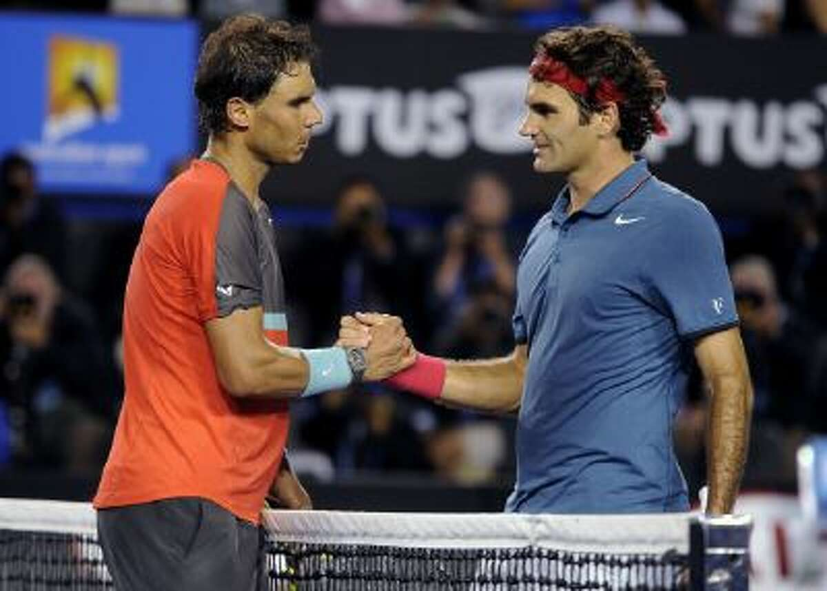 Rafael Nadal of Spain, left, is congratulated by Roger Federer of Switzerland at the net after Nadal won their semifinal final at the Australian Open tennis championship in Melbourne, Australia.