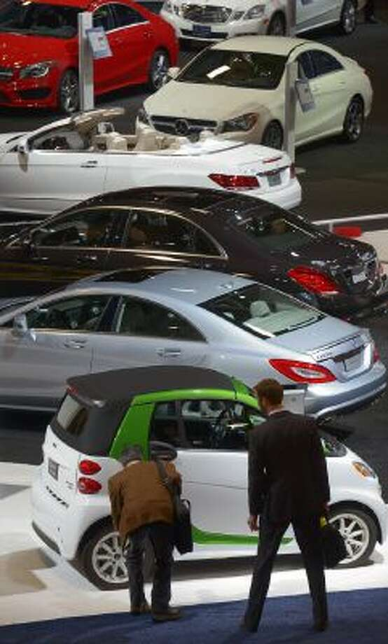 Visitors check out some of the new cars as the annual Auto show sets up to open Thursday at the convention center on Jan. 22 in Washington, DC.