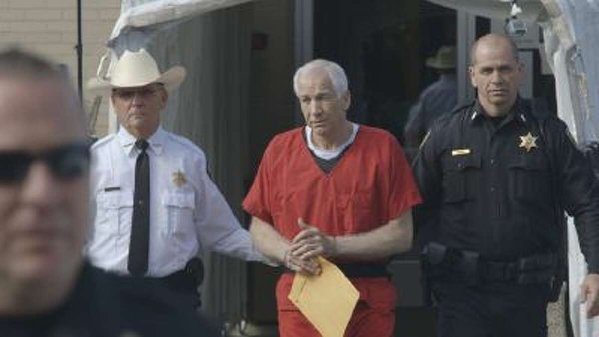 This photo shows Jerry Sandusky, center, in the documentary film,