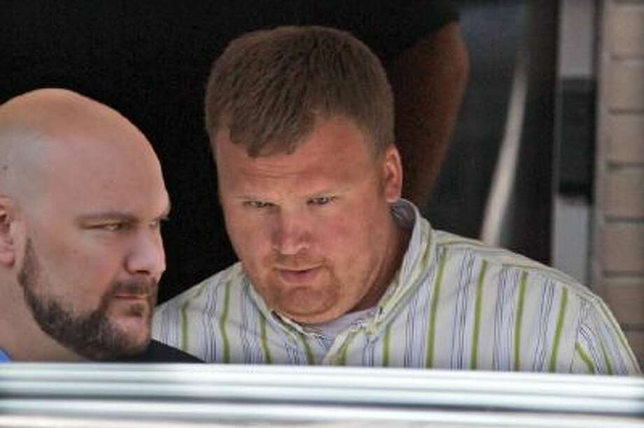 """Matt Sandusky, right, the adopted son of former Penn State University assistant football coach Jerry Sandusky leaves the Centre County Courthouse in Bellefonte, Pa. Matt Sandusky is participating in the documentary """"Happy Valley"""" about his father's sexual-abuse case to advocate for child sexual-abuse survivors."""
