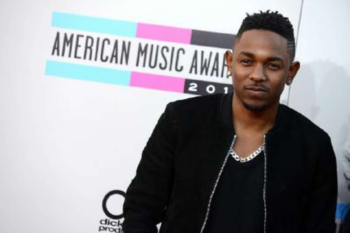 In this Nov. 24, 2013 photo, Kendrick Lamar arrives at the American Music Awards at the Nokia Theatre L.A. Live, in Los Angeles.