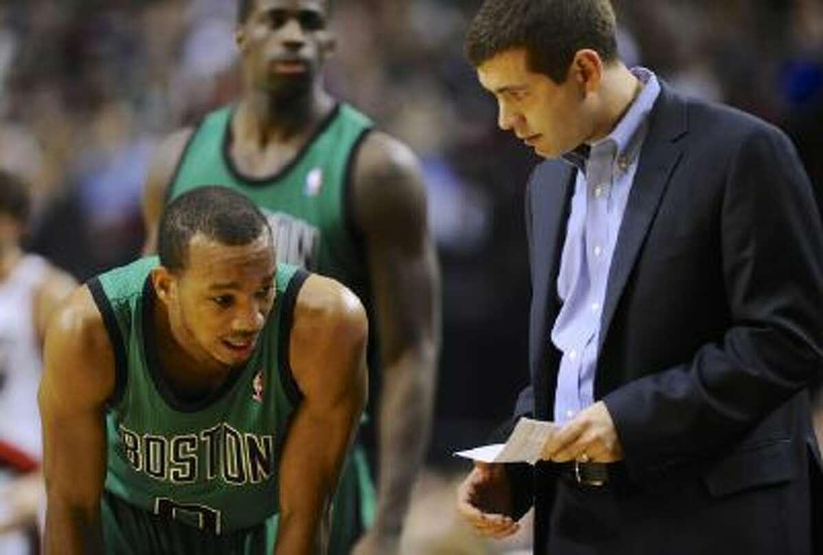 Boston Celtics' Avery Bradley (0) speaks with head coach Brad Stevens during a game earlier this season.