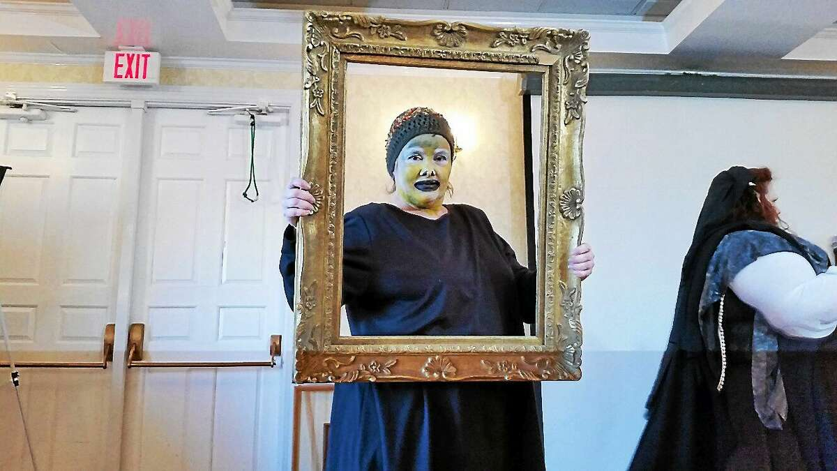 A contest participant from Torrington's Warner Theatre team dresses as a classic clown painting during a spoof of a talent contest at the 25th annual Possum Queen event at the Litchfield Inn at 432 Bantam Road in Litchfield on Saturday afternoon. It was estimated that this year's event that pitted team-driven skits against each other raised approximately $60,000 for local families in need.