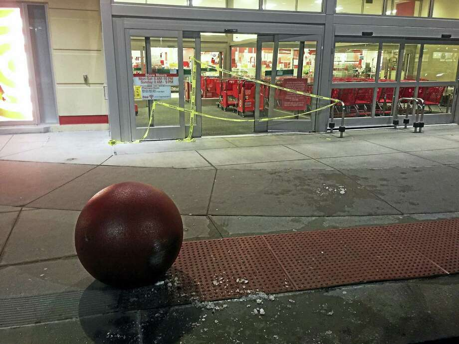 (BEN LAMBERT - Register Citizen) A motorist crashed into the Target on East Main Street this evening, damaging the store's automatic doors. Photo: Journal Register Co.