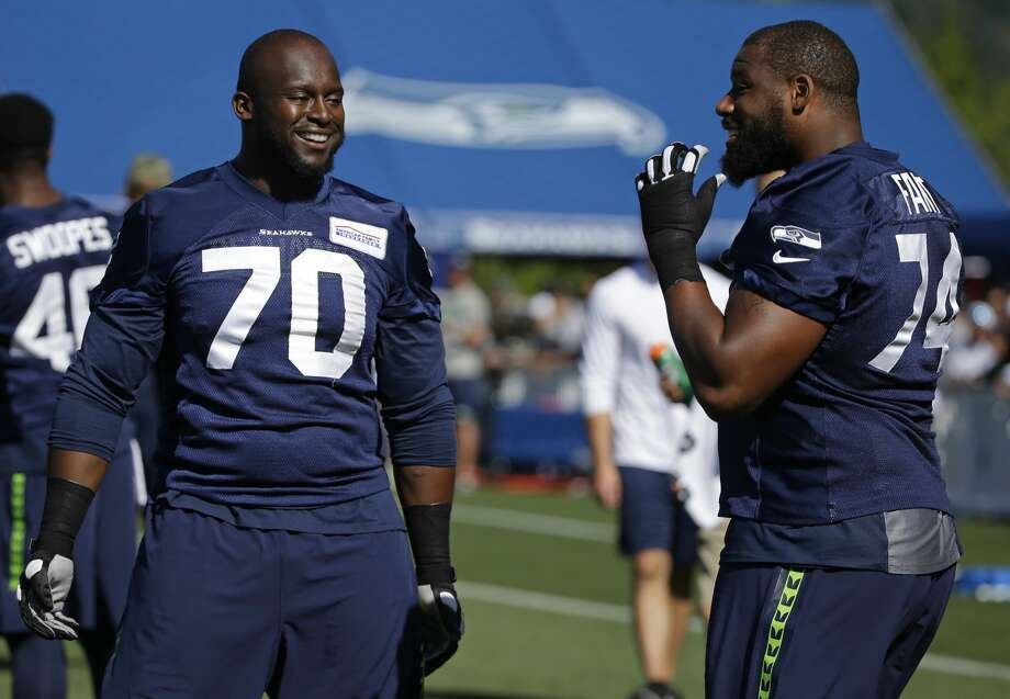 Seattle Seahawks offensive guard Rees Odhiambo (70) and offensive tackle George Fant, right, talk during NFL football training camp, Sunday, July 30, 2017, in Renton, Wash. (AP Photo/Ted S. Warren) Photo: Ted S. Warren/AP