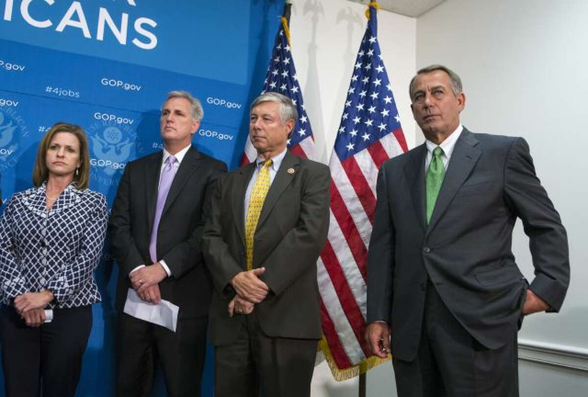 House Speaker John Boehner of Ohio, right, and House GOP leaders, participate in a news conference on Capitol Hill in Washington, Thursday, Sept. 26, 2013, as pressure builds over legislation to prevent a partial government shutdown. From left are, Rep. Lynn Jenkins, R-Kansas, House Majority Whip Kevin McCarthy of Calif., House Energy and Commerce Committee Chairman Rep. Fred Upton, R-Mich. and Boehner. (AP Photo/J. Scott Applewhite)