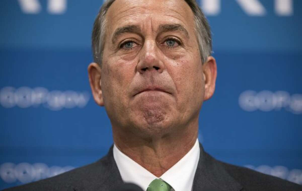 House Speaker John Boehner of Ohio, and House GOP leaders, speak to reporters on Capitol Hill in Washington, Thursday, Sept. 26, 2013, after a closed-door strategy session. Pressure is building on fractious Republicans over legislation to prevent a partial government shutdown, as the Democratic-led Senate is expected to strip a tea party-backed plan to defund the Affordable Care Act, popularly known as