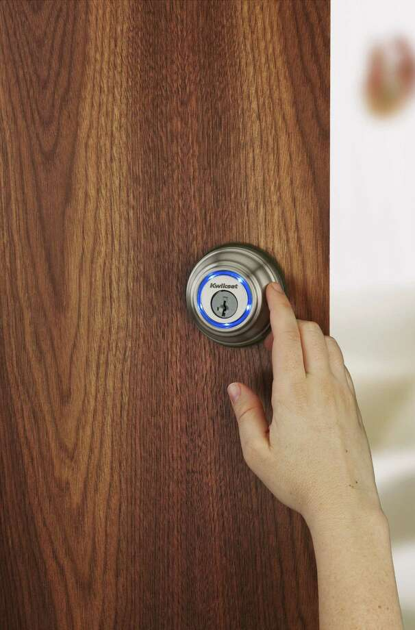 This photo provided by Kwikset.com shows the companyís Kevo lock, a Bluetooth-enabled deadbolt that turns your smartphone into an electronic key. Kevo locks and unlocks with the touch of a finger while your smartphone remains in your purse or pocket. Kevo owners can send eKeys to others through the Kevo app, and delete them at any time. (Kwikset.com via AP) Photo: AP / Kwikset.com