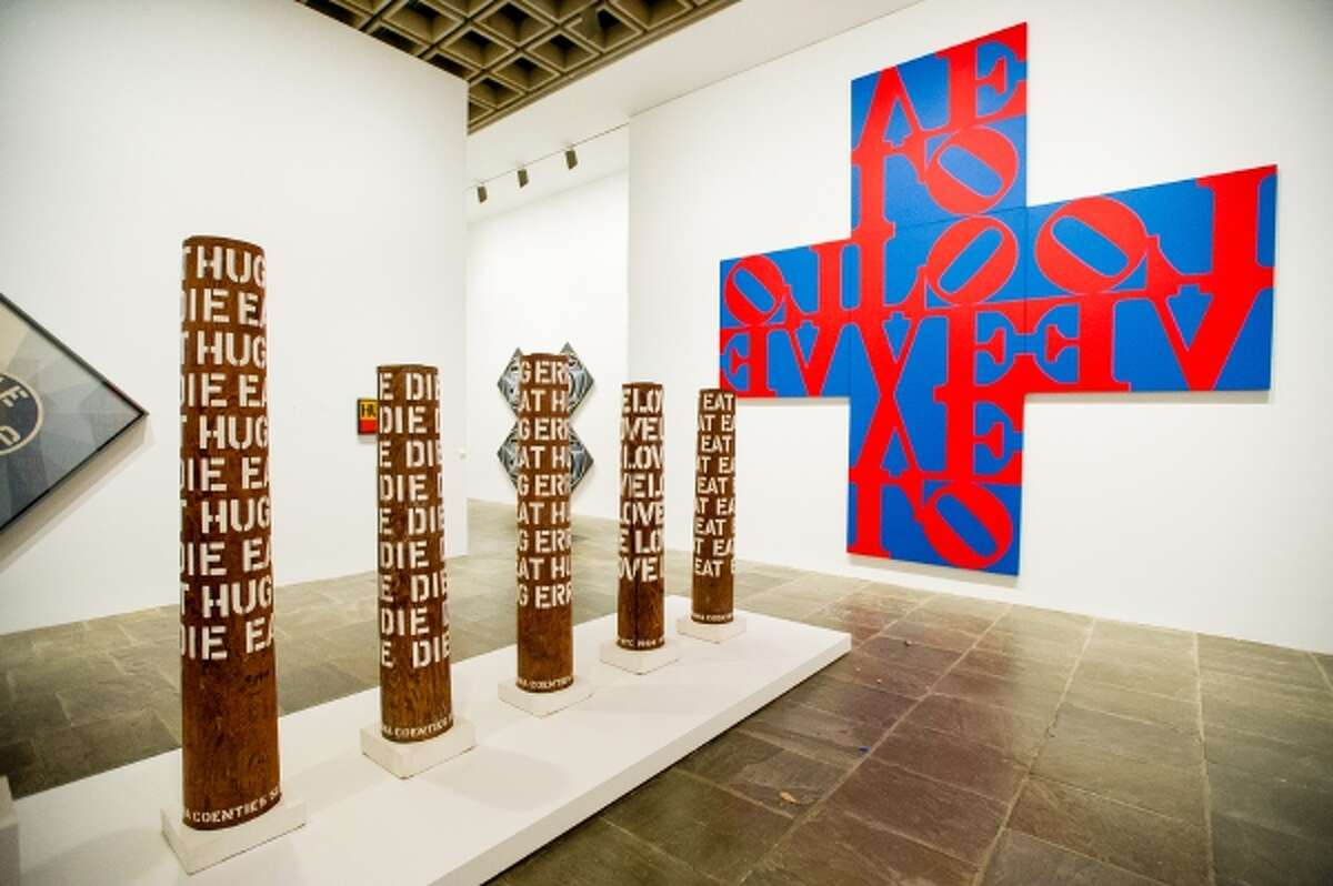 In this Sept. 24, 2013 photo, the works of artist Robert Indiana, known world over for his LOVE image, are on display at New York's Whitney Museum of American Art. Indiana, who turned 85 this month, called the retrospective of 95 works he created over the past five decades,
