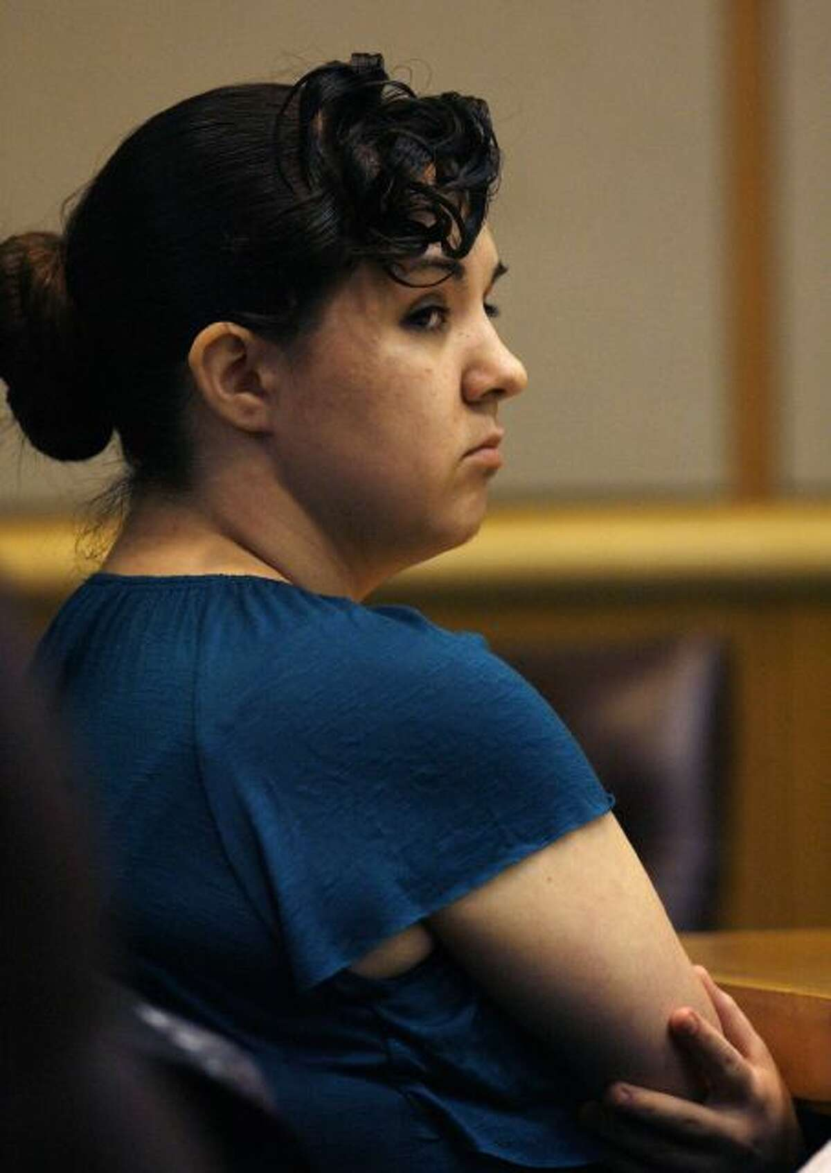 Defendant Jennifer Mee watches members of the jury during her trial on Friday, Sept. 20, 2013, 2013. Mee and two men are charged in the death of Shannon Griffin, a 22-year-old Wal-Mart worker. Prosecutors say Mee lured Griffin to a St. Petersburg home under the pretense of buying marijuana, but instead, two of Mee's friends robbed him at gunpoint. Griffin struggled with the suspects and was shot several times. Mee gained fame because of her uncontrolled hiccupping as a teenager . Videos of her hiccupping gained her national attention, as did her attempts to quell the problem. (AP Photo/The Tampa Bay Times, Scott Keeler, Pool)