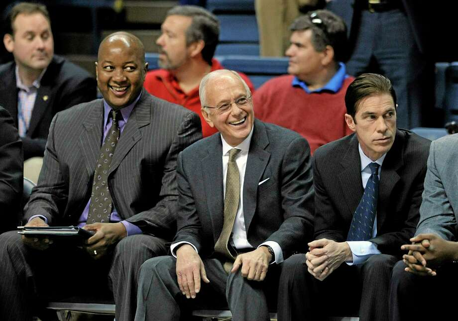 SMU head coach Larry Brown, center, enjoys a moment before his team's 64-55 victory over Connecticut in Storrs on Sunday. Photo: Fred Beckham — The Associated Press  / FR153656 AP