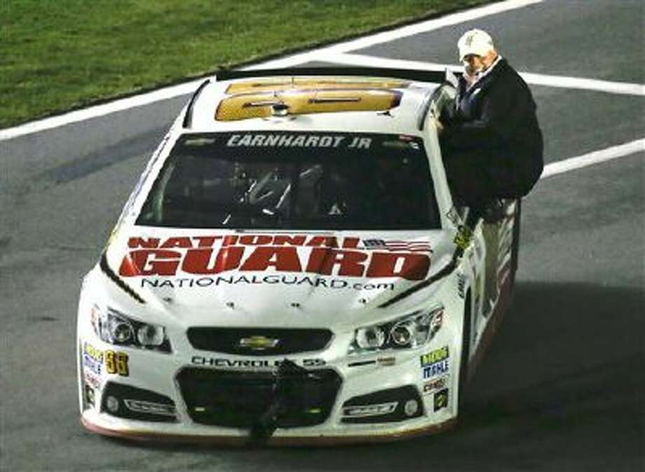Car owner Rick Hendrick rides with Dale Earnhardt Jr. to Victory Lane as they celebrate after winning the Daytona 500 NASCAR Sprint Cup Series auto race at Daytona International Speedway in Daytona Beach, Fla., Sunday, Feb. 23, 2014. (AP Photo/John Raoux) Photo: AP / AP