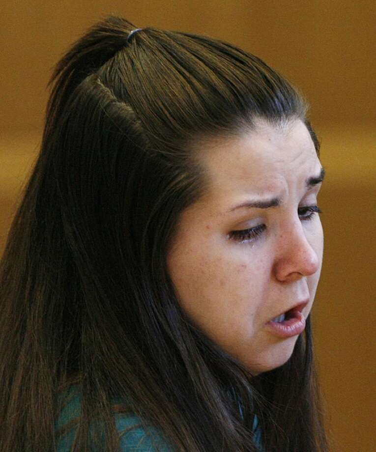 Jennifer Mee holds reacts as the jury selection begins in her murder trial, Tuesday, Sept. 17, 2013, at the Pinellas County Justice Center in Clearwater, Fla. Mee, 22, who found fame in 2007 as a teen because of her uncontrollable hiccupping, is charged with first-degree murder in the 2010 death of Shannon Griffin. (AP Photo/The Tampa Bay Times, Scott Keeler, Pool) Photo: AP / Pool The Tampa Bay Times