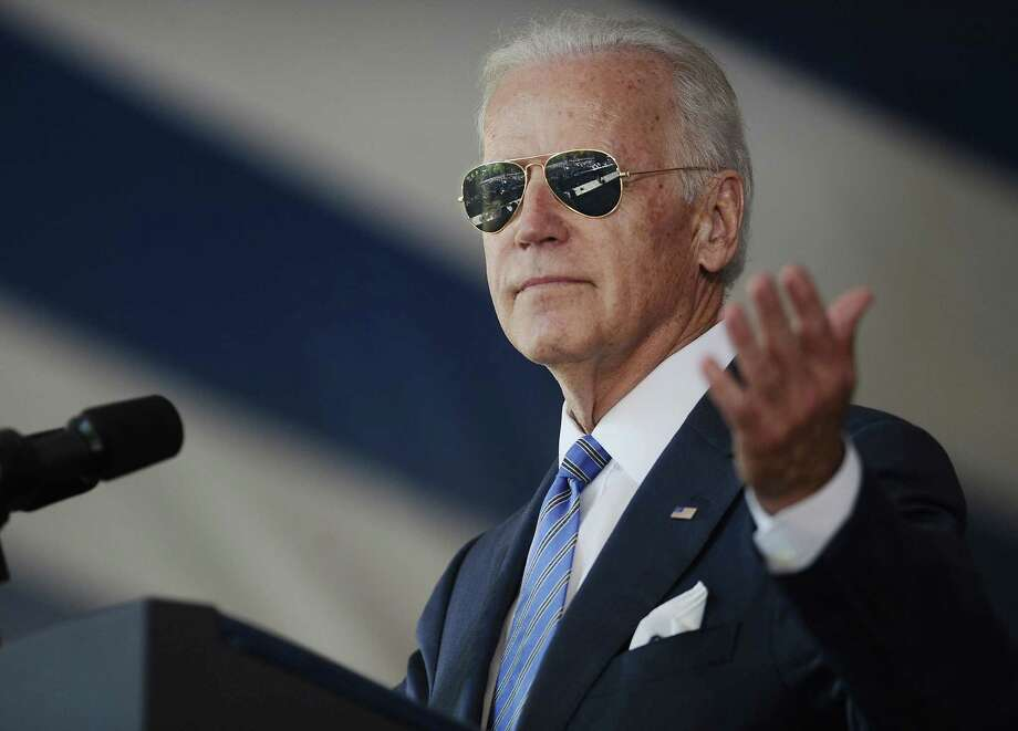 FILE - In this May 17, 2015, file photo, Vice President Joe Biden gestures after donning a pair of sunglasses as he delivers the Class Day Address at Yale University in New Haven, Conn. Graduation season is winding down but among the eight commencement addresses given this year by three of the biggest names, President Barack Obama, first lady Michelle Obama and Vice President Joe Biden, a few moments stood out that may last a little longer. (AP Photo/Jessica Hill, File) Photo: AP / FR125654 AP