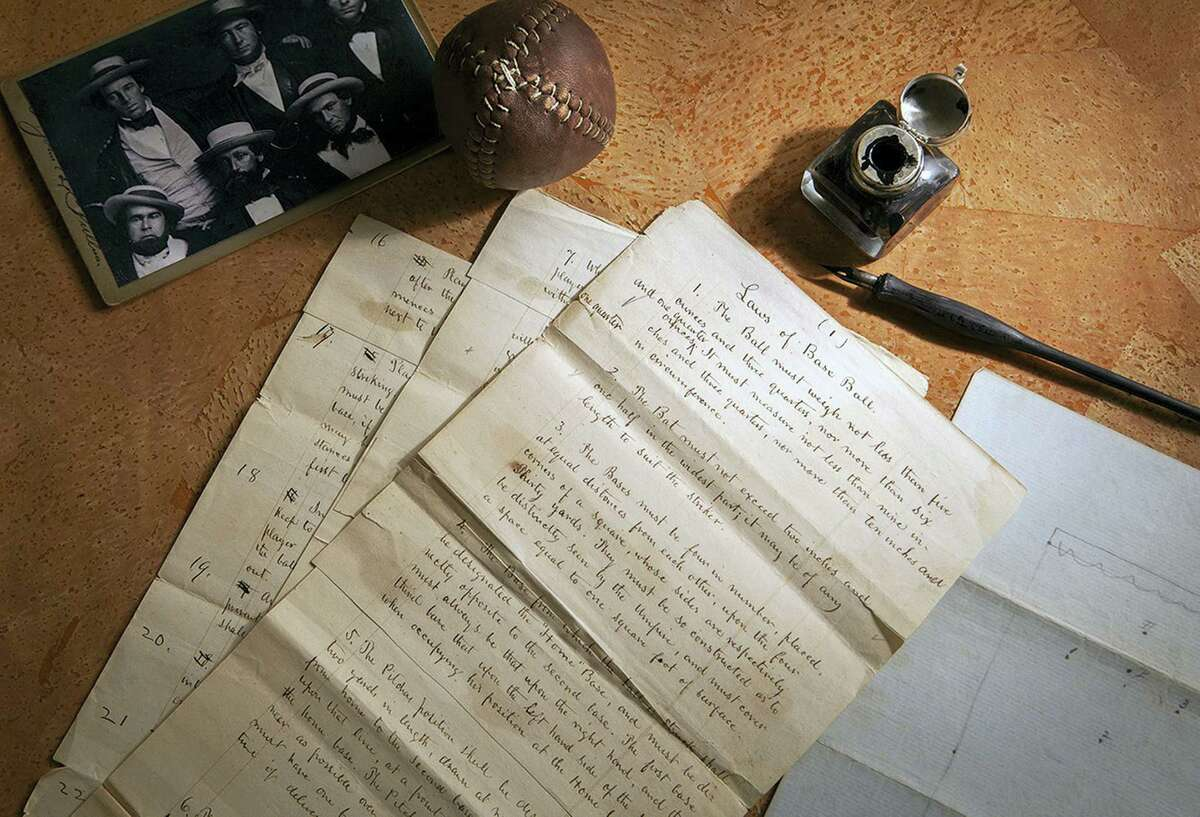 """This Feb. 11, 2016 photo provided by SCP Auctions shows the 1857 documents titled """"Laws of Base Ball."""" Baseball may have found its birth certificate. And with it a new birth date, and new founding father. Coinciding with the start of the professional baseball season, a set of game-changing documents went up for sale this week. Their authenticity and significance are verified by experts including John Thorn, Major League Baseball's official historian. (Leslie Larsen Bird/SCP Auctions via AP)"""