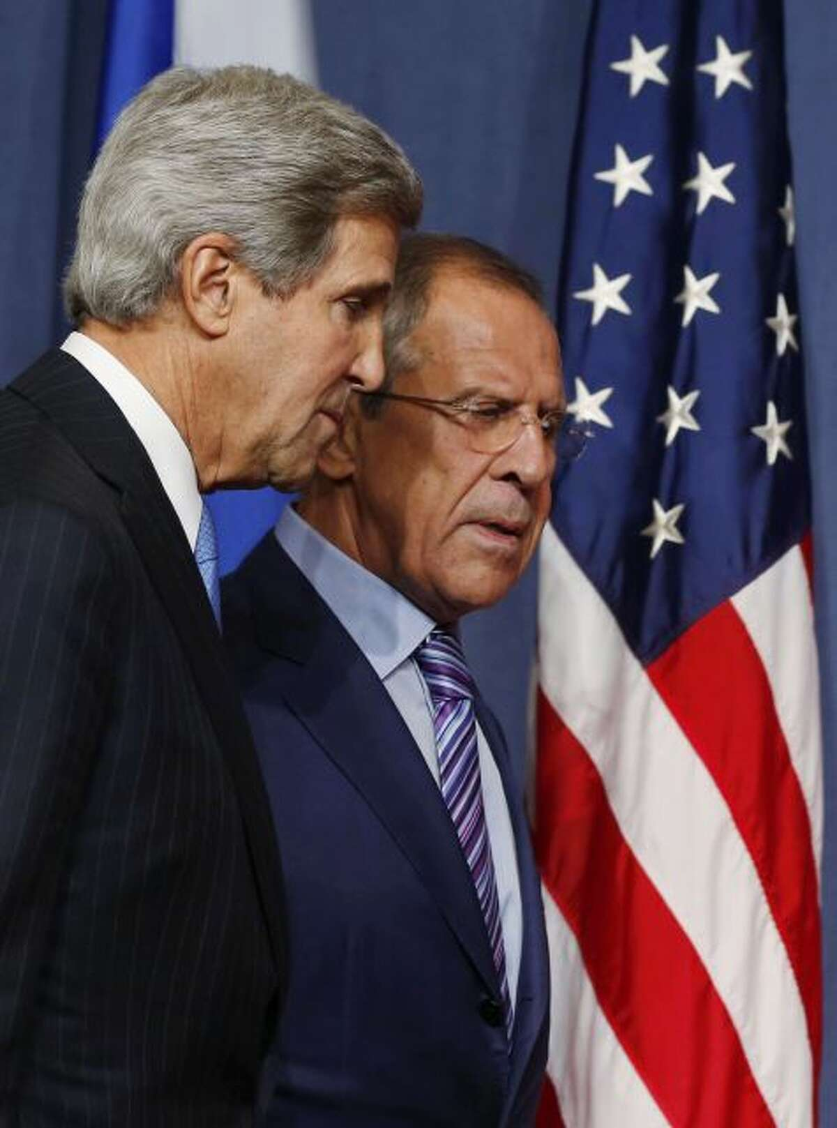 U.S. Secretary of State John Kerry and Russian Foreign Minister Sergey Lavrov, right, arrive for their press conference before their meeting to discuss the ongoing crisis in Syria, in Geneva, Switzerland, Thursday Sept. 12, 2013. Secretary of State John Kerry and his team have opened two days of meetings with their Russian counterparts in Geneva. Kerry is hoping to come away with the outlines of a plan for securing and destroying vast stockpiles of Syrian chemical weapons. (AP Photo/Larry Downing, Pool)