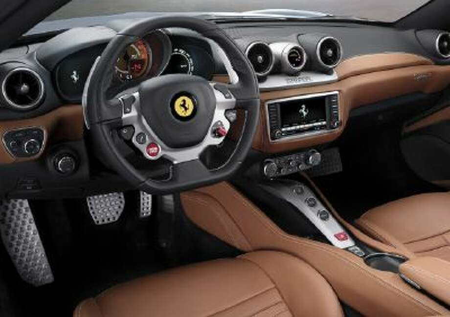 Inside the car gets a new touch screen and the same multifunction steering wheel found in the 458 Italia and F12 Berlinetta.