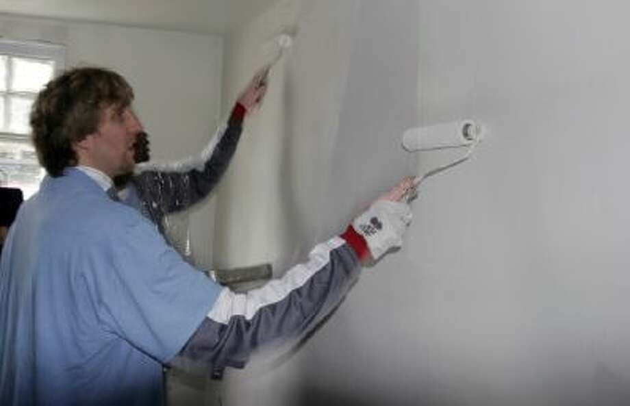 In this Feb. 15, 2008 file photo, Dallas Mavericks basketball star Dirk Nowitzki, of Germany, paints a wall in a home in the Lower 9th ward of New Orleans. This week marks six years since NBA All-Stars ventured into New Orleans neighborhoods devastated by Hurricane Katrina to lend a hand with rebuilding.