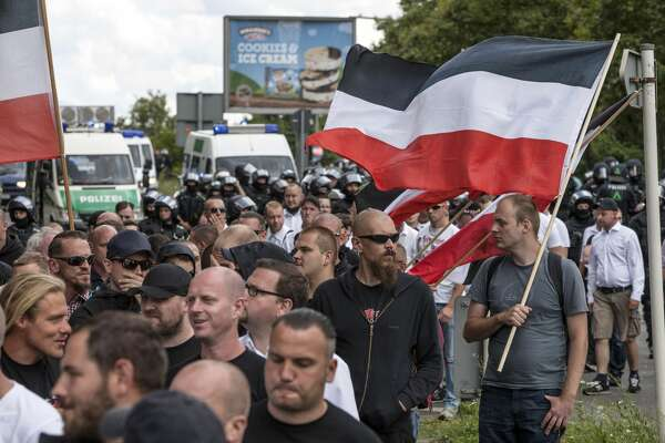 Some 1000 participants affiliated with Neo-Nazi and extreme right groups marched through the street of Berlin's Spandau district in commemoration of 30 years to Rudolf Hess's death, on August 19, 2017 in Berlin, Germany. Hess committed suicide on August 17, 1987 at Spandau Prison and he also served as Adolf Hitler's deputy. The march attracted counter demonstrations along its route, organized by several left-wing groups and political parties. (Photo by Omer Messinger/Getty Images)