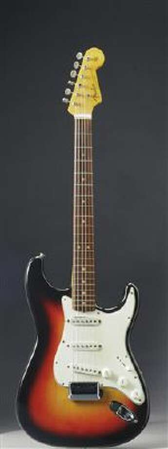 This undated photo provided by Christie's shows the Fender Stratocaster a young Bob Dylan played at the historic 1965 Newport Folk Festival. On Dec. 6, 2013, it could bring as much as half a million dollars when it comes up for auction at Christie's New York. Photo: AP / Christie's