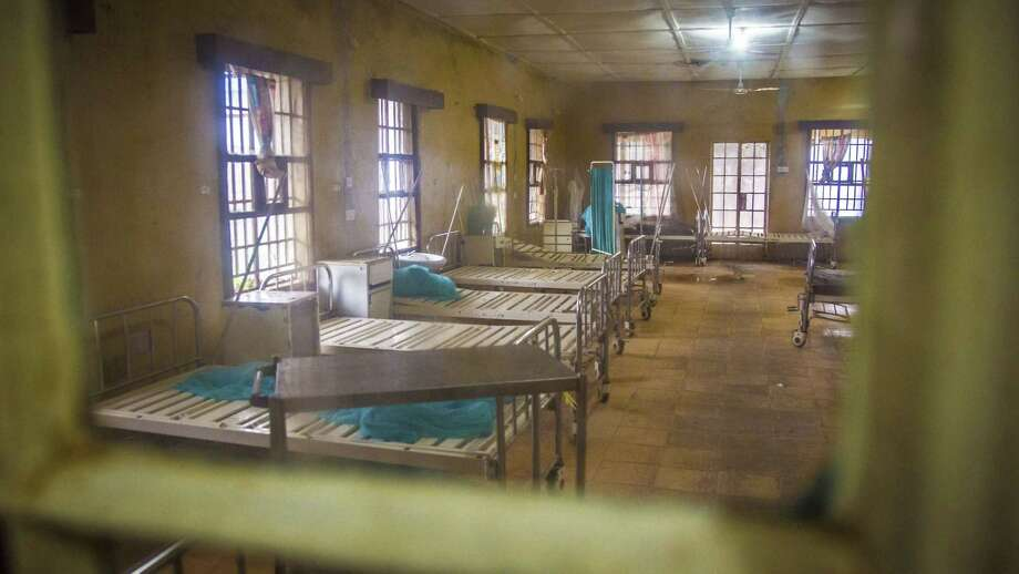 ADVANCE FOR USE SUNDAY, SEPT. 20, 2015 AT 9 P.M. EDT (0100 GMT) AND THEREAFTER - FILE - In this Sunday, Aug. 10, 2014 file photo, a ward at the government hospital in Kenema, eastern Sierra Leone lies empty after patients left and others were scared to be admitted, fearing they would contract the Ebola virus. More than 40 health workers at the facility have died from the virus. An Associated Press investigation has found a toxic mix of avoidable problems faced by Ebola responders, including weak leadership, shoddy supplies and infighting, exacerbated a chaotic situation at a critical front in the battle against the virus. (AP Photo/Michael Duff, File) Photo: AP / AP