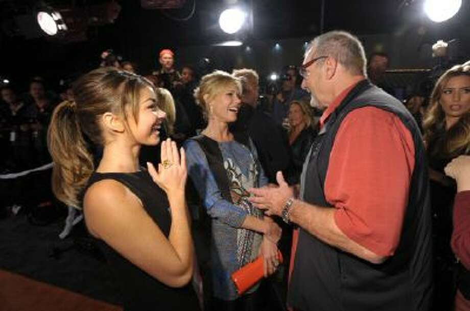 """Cast members, from left, Sarah Hyland, Julie Bowen, and Ed O'Neill attend USA Network's """"Modern Family"""" Fan Appreciation Day at the Westwood Village Theatre on Monday, Oct. 28, 2013 in Los Angeles."""