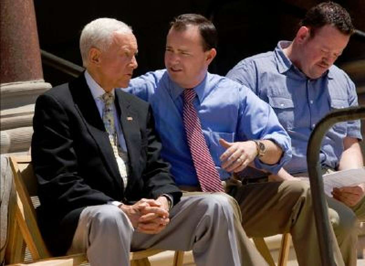 Utah Senators Orrin Hatch, left and Mike Lee talk before a rally for a balanced budget amendment at the Salt Lake City-County Building Friday July 8. State Representative Karl Wimmer at right.