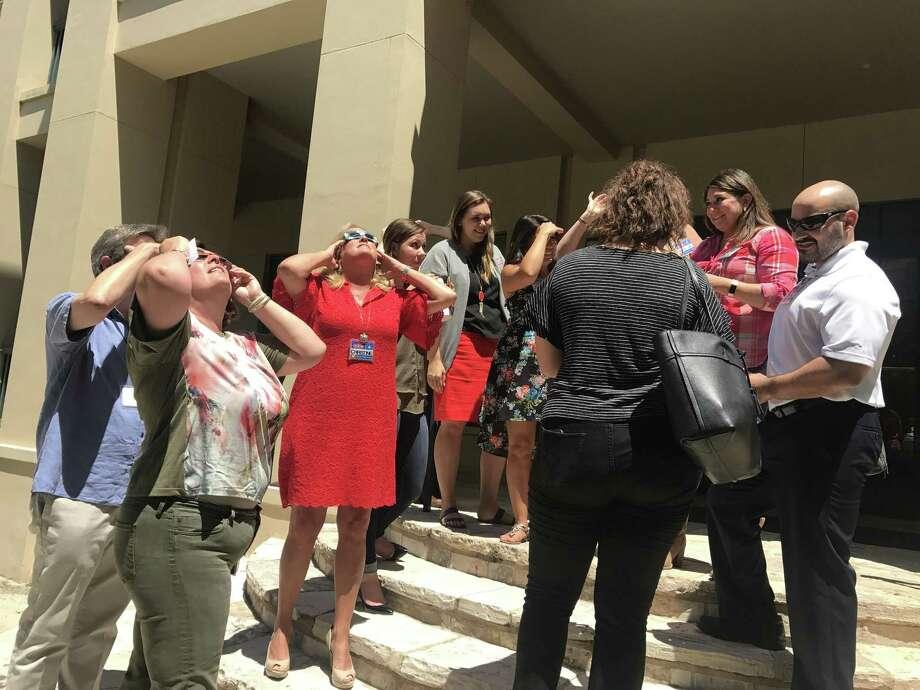 Marketing employees at H-E-B's Arsenal headquarters in downtown San Antonio gaze at the solar eclipse Aug. 21, 2017. Photo: Courtesy /H-E-B /Courtesy /H-E-B