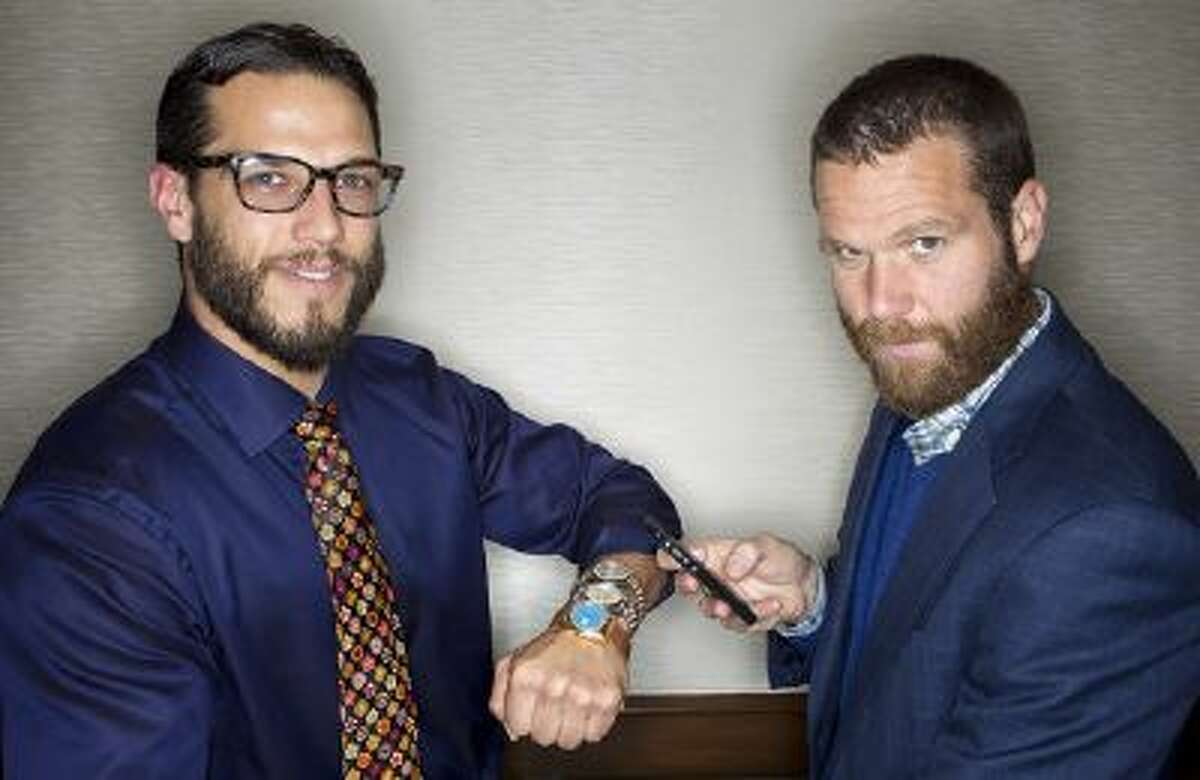 From left, Josh and Kris Bonifas pose with vintage Rolex watches and an iPhone at FourtanÈ in Carmel-by-the-Sea, Calif., on Friday, July, 19, 2013.