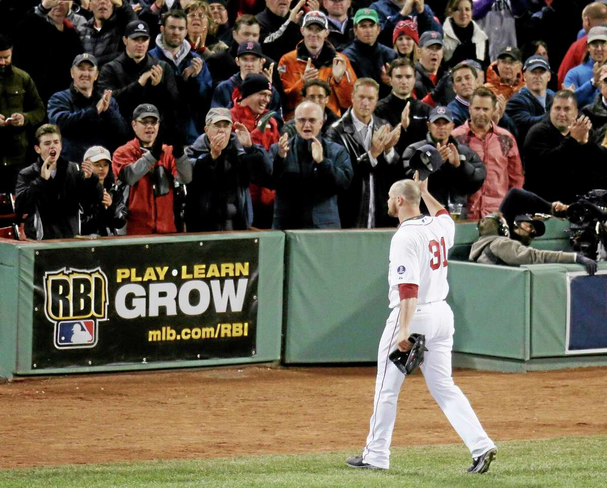 Boston Red Sox starting pitcher Jon Lester acknowledges the crowd as he leaves the game during the eighth inning of Game 1 of baseball's World Series against the St. Louis Cardinals Wednesday, Oct. 23, 2013, in Boston. (AP Photo/Charlie Riedel)